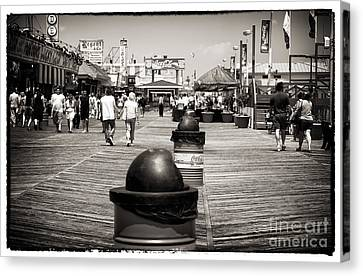 Walking The Boardwalk Canvas Print by John Rizzuto