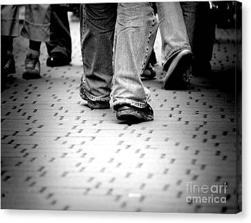 Walking Through The Street Canvas Print by Michal Bednarek