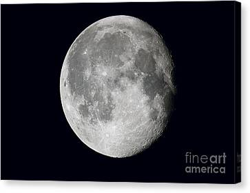 Waning Moon And Lunar Landscape Canvas Print by John Chumack