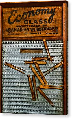 Washboard And Clothes Pins Canvas Print by Paul Ward