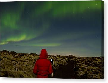 Watching The Northern Lights Canvas Print by Andres Leon