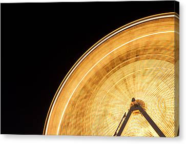 Watching The Wheel Go Round Canvas Print by Heidi Smith