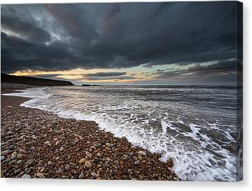 Water Coming Up On The Shore Canvas Print by John Short