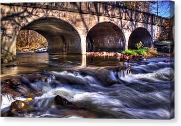 Water Under Bridge Canvas Print by Tim Buisman