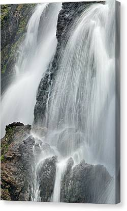 Waterfall In Spring Canvas Print by Guido Montanes Castillo