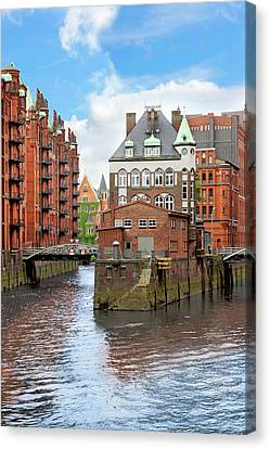 Waterfront Warehouses And Lofts Canvas Print by Miva Stock
