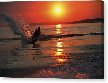 Waterskiing At Sunset Canvas Print by Misty Bedwell