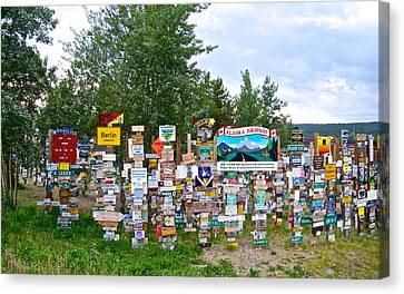 Watson Lake Sign Forest Along Alaska Highway In  Yukon-canada Canvas Print by Ruth Hager