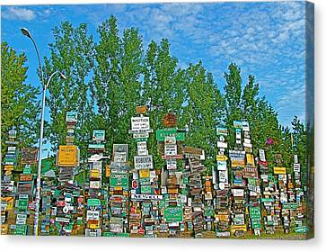 Watson Lake Sign Forest-yt Canvas Print by Ruth Hager