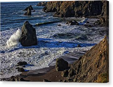 Wave Breaking On Rock Canvas Print by Garry Gay