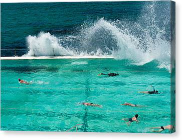 Waves Breaking Over Edge Of Pool Canvas Print by Panoramic Images
