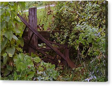 Where An Old Plow Rests  Canvas Print by Jeff Swan