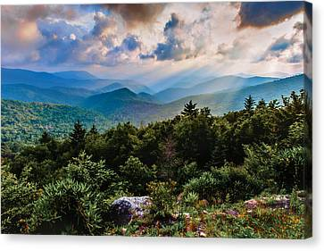 Whispered Light Canvas Print by Rob Travis