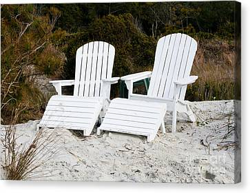 White Adirondack Chairs In The Sand Canvas Print by Thomas Marchessault