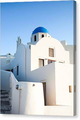 White Buildings And Blue Church In Oia Santorini Greece Canvas Print by Matteo Colombo