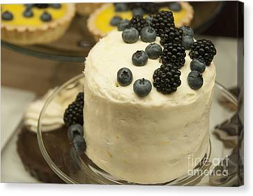 White Frosted Cake With Berries Canvas Print by Juli Scalzi