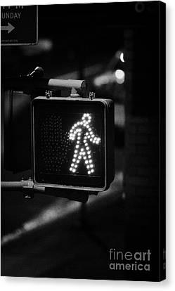 White Man Pedestrian Walk Sign Illuminated At Night New York City Usa Canvas Print by Joe Fox