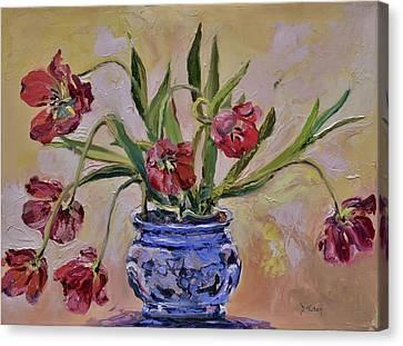 Wilting Tulips Canvas Print by Donna Tuten