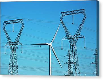 Wind Turbine And Electricity Pylons Canvas Print by Jim West