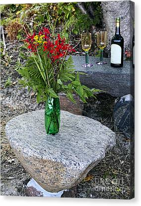 Wine And Red Flowers On The Rocks Canvas Print by Les Palenik