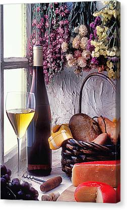 Wine Bottle With Glass In Window Canvas Print by Garry Gay