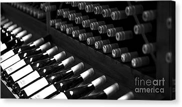 Wine Bottles On A Rack At A Winery Near The Vineyards Canvas Print by ELITE IMAGE photography By Chad McDermott