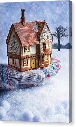 Winter Cottage In Gloved Hand Canvas Print by Amanda And Christopher Elwell