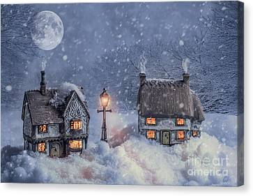 Winter Cottages In Snow Canvas Print by Amanda And Christopher Elwell