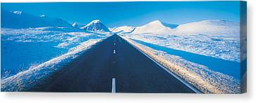 Winter Road Glencoe Scotland Canvas Print by Panoramic Images