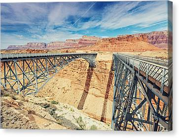 Wispy Clouds Over Navajo Bridge North Rim Grand Canyon Colorado River Canvas Print by Silvio Ligutti