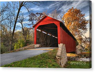 Wispy Clouds Over The Poole Forge Covered Bridge Canvas Print by Adam Jewell