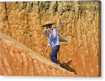 Woman Carrying Basket On Clay Hill Canvas Print by Keren Su