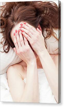 Woman Covering Face With Hands Canvas Print by Ian Hooton