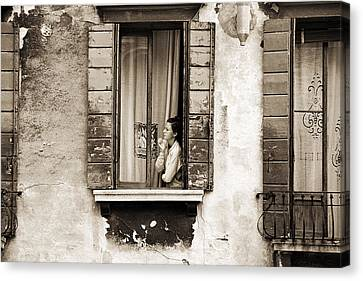 Woman Gazing Out Of A Window Contemplating Canvas Print by Stephen Spiller