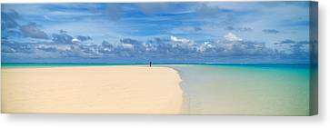 Woman In Distance On Sandbar, Aitutaki Canvas Print by Panoramic Images