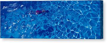 Woman In Swimming Pool Canvas Print by Panoramic Images