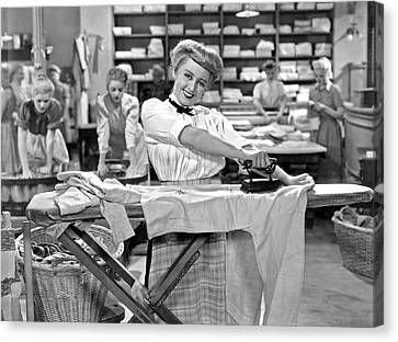 Woman Ironing In Laundry Canvas Print by Underwood Archives
