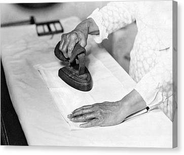 Woman Ironing With Flat Iron Canvas Print by Underwood Archives