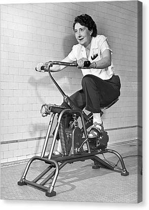 Woman On Exercycle Canvas Print by Underwood Archives