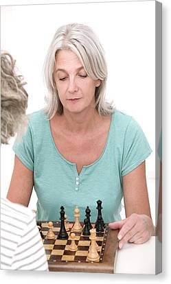Woman Playing Chess Canvas Print by Lea Paterson