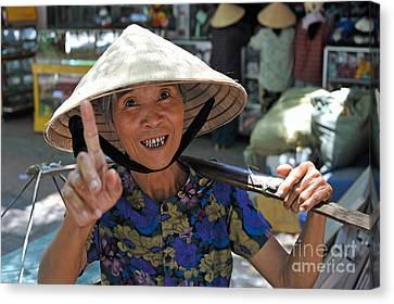 Woman Portrait At Market In Hue Canvas Print by Sami Sarkis