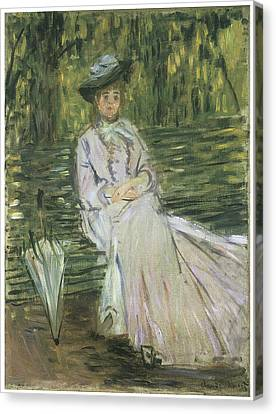 Woman Seated On A Bench Canvas Print by Claude Monet