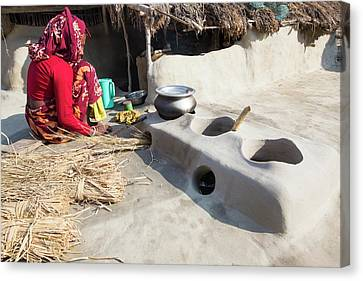 Woman Subsistence Farmer Cooking Canvas Print by Ashley Cooper