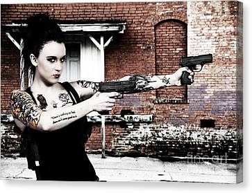 Woman With Pistols Canvas Print by Rob Byron