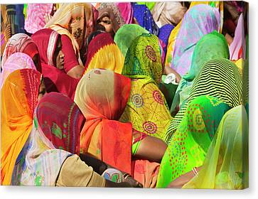 Women In Colorful Saris Gather Canvas Print by Keren Su
