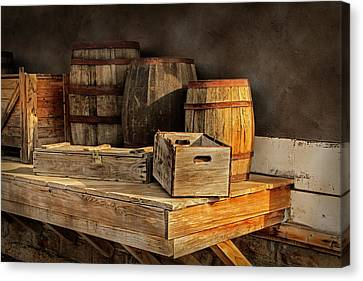 Wooden Barrels And Crates On A Shelf At A Railroad Station Canvas Print by Randall Nyhof