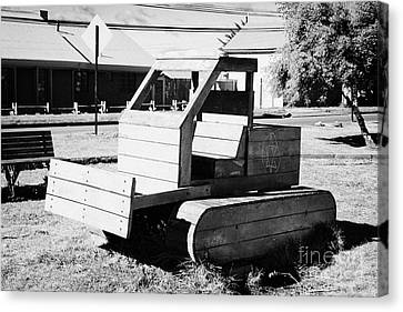 wooden bulldozer in a childrens play area with grafitti star of david scraped onto the side Punta Arenas Chile Canvas Print by Joe Fox