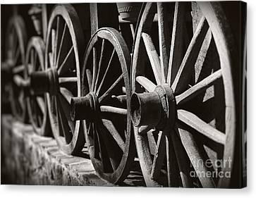 Wooden  Wagon Wheels Canvas Print by Martin Dzurjanik