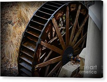 Wooden Water Wheel Canvas Print by Paul Ward