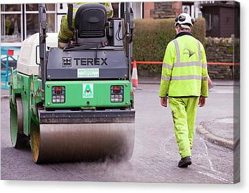 Workmen Replacing Road Surface Canvas Print by Ashley Cooper